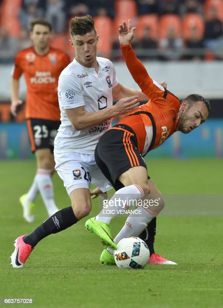 Lorient's French forward Romain Philippoteaux vies with Caen's French defender Frederic Guilbert during the French L1 football match between Lorient...