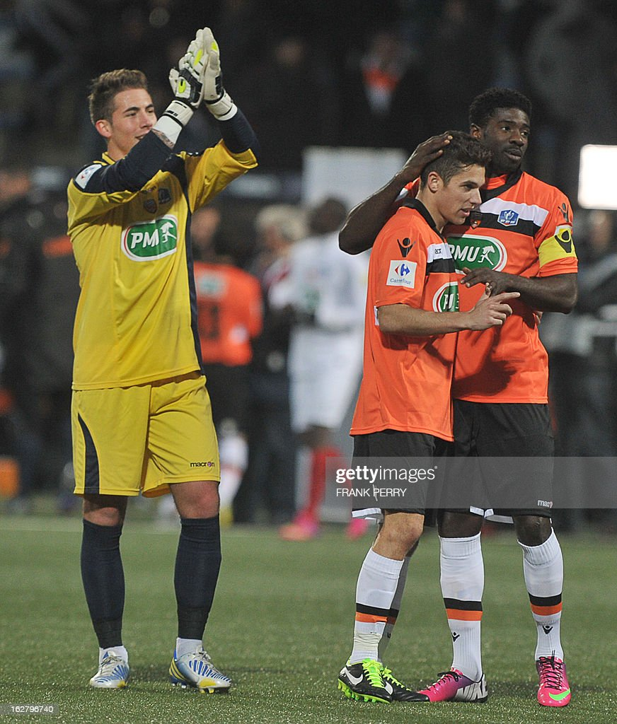 Lorient's French goalkeeper Benjamin Lecomte, players Maxime Barthelme (C) and Bruno Ecuele Manga (R) celebrate after a goal during the French Cup football match Lorient vs Brest, on February 27, 2013 at the Stadium of Moustoir in Lorient, western France.