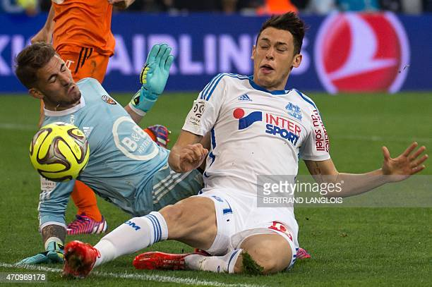 Lorient's French goalkeeper Benjamin Lecomte vies with Marseille's Argentinian midfielder Lucas Ocampos during the French L1 football match between...