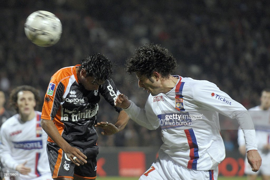 Lorient's French midfielder Fabrice Abriel (L) vies with Lyon's defender Fabio Grosso (R) during their French L1 football match, 23 January 2008 at the Gerland stadium in Lyon.
