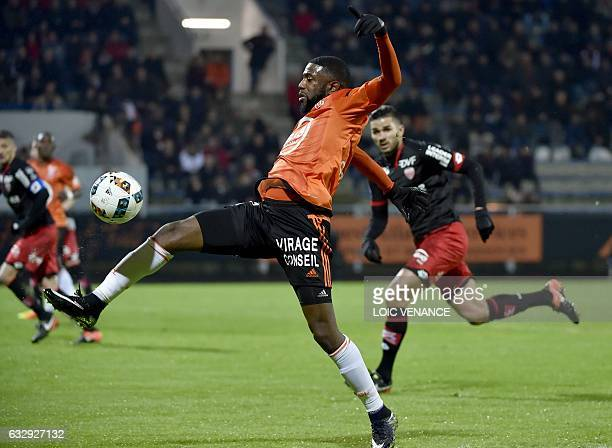 Lorient's French midfielder Makengo Arnold Mvuemba vies with Dijon's FrenchAlgerian midfielder Mehdi Abeid during the French L1 football match...