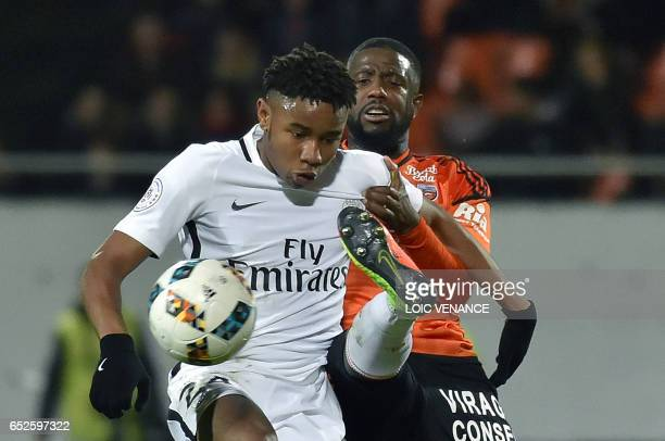 Lorient's French midfielder Makengo Arnold Mvuemba vies with Paris SaintGermain's French midfielder Christopher Nkunku during the French L1 football...