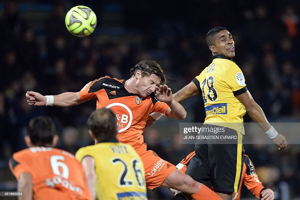 Lorient's French midfielder Medhi Mostefa-Sba (L) jumps for the ball with Lille's French defender Franck Beria during the French L1 football match between Lorient (FCL) and Lille (LOSC) on January 17, 2015 at the Moustoir stadium in Lorient, western France. AFP PHOTO / JEAN-SEBASTIEN EVRARD