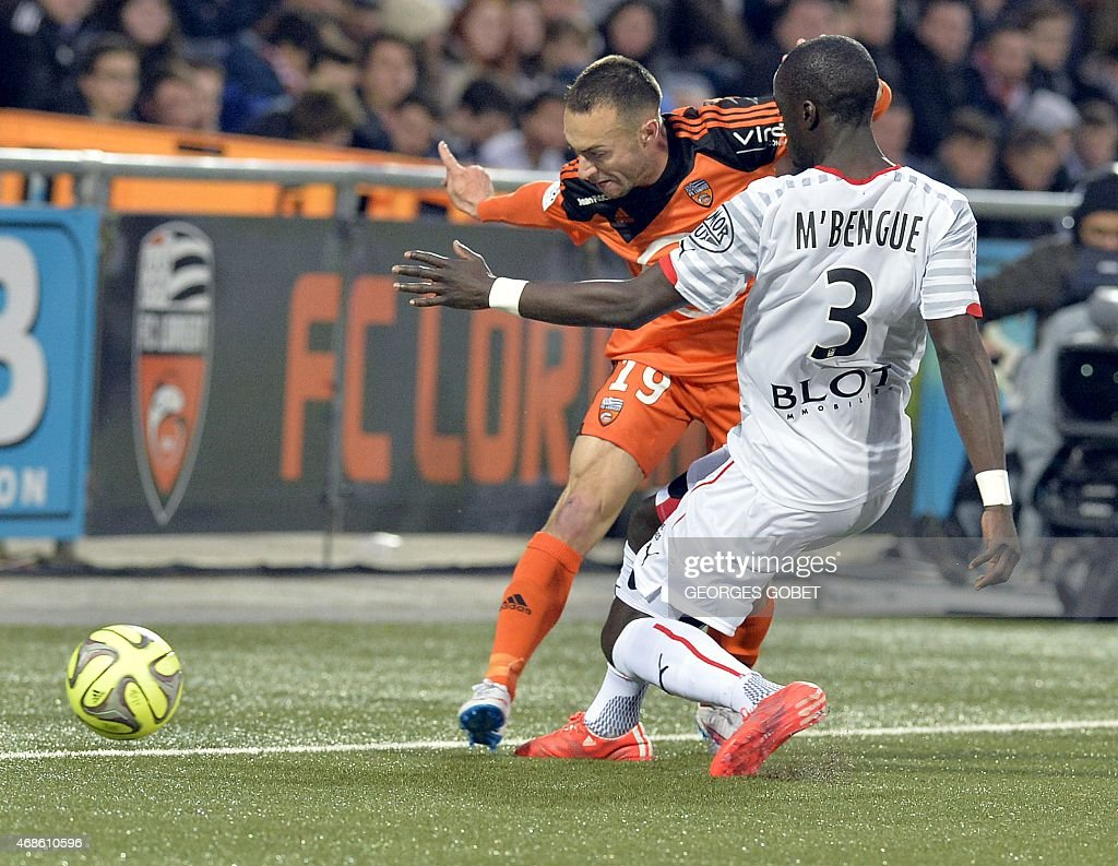 Lorient's French midfielder Romain Philippoteaux (L) and Rennes' French Senegalese defender Cheik Mbengue fight for the ball during the French L1 football match between FC Lorient and Stade Rennais FC on April 4, 2015 at the Stade du Moustoir in Lorient.