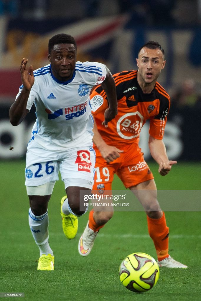 Lorient's French midfielder Romain Philippoteaux (R) vies with Marseille's Ivorian defender Brice Dja Djedje during the French L1 football match between Marseille and Lorient on April 24, 2015 at the Velodrome stadium in Marseille, southern France.