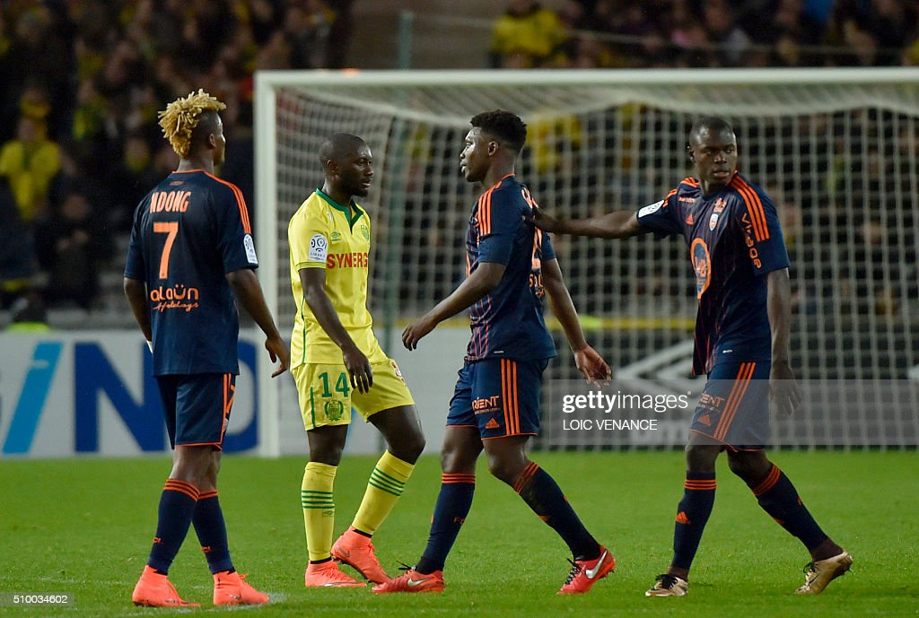 Lorient's French Senegalese defender Lamine Gassama (C) leaves the pitch after receiving a red card during the French L1 football match between Nantes (FCN) and Lorient (FCL) at La Beaujoire Stadium in Nantes, western France, on February 13, 2016. AFP PHOTO / LOIC VENANCE / AFP / LOIC VENANCE