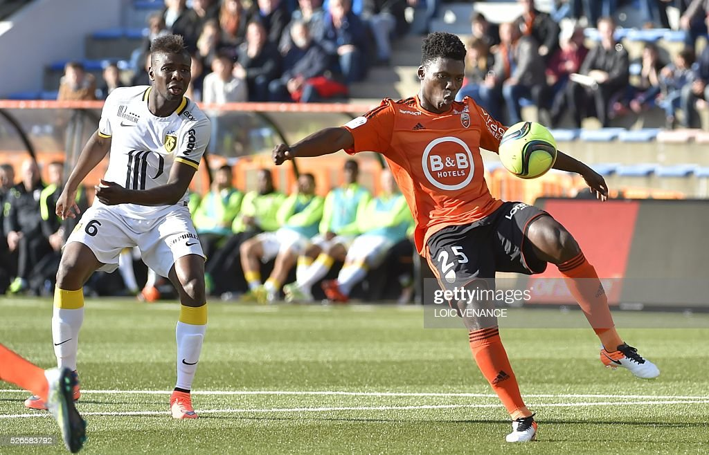 Lorient's French Senegalese defender Lamine Gassama (R) vies with Lille's French midfielder Ibrahim Amadou during the French L1 football match Lorient vs Lyon at the Moustoir stadium in Lorient, western France, on April 30, 2016.