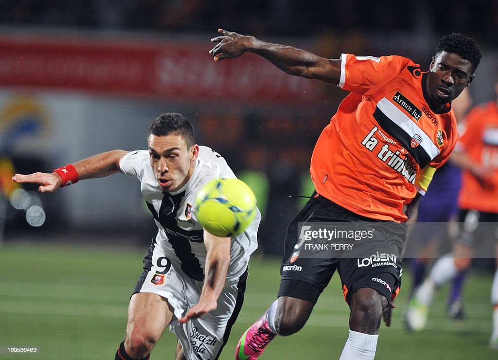 Lorient's Gabonese defender Ecuele Manga Bruno (R) vies with Rennes' French forward Mevlut Erding (L) during the French L1 football match Lorient vs Rennes on February 2, 2013 at the Moustoir Stadium in Lorient, western France.
