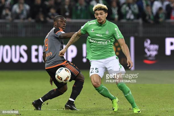 Lorient's Ghanaian forward Abdul Majeed Waris vies with SaintEtienne's French defender Kevin Malcuit during the French L1 Football match between AS...