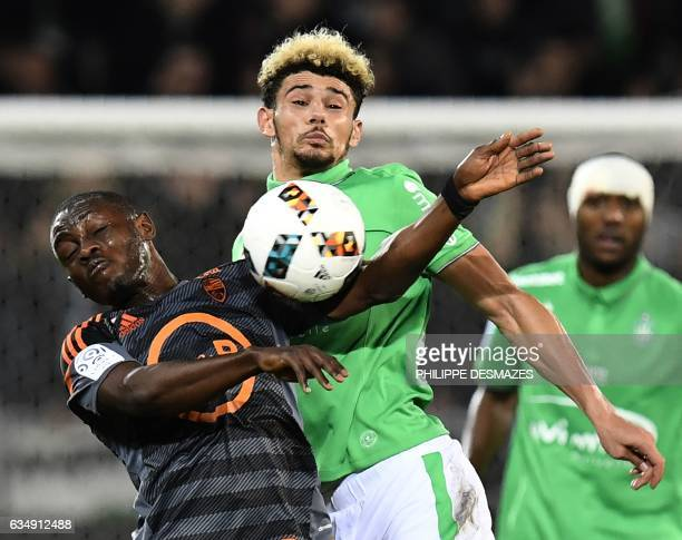 Lorient's Ghanaian forward Abdul Waris Majeed vies with SaintEtienne's French defender Kevin Malcuit during the French L1 football match between AS...