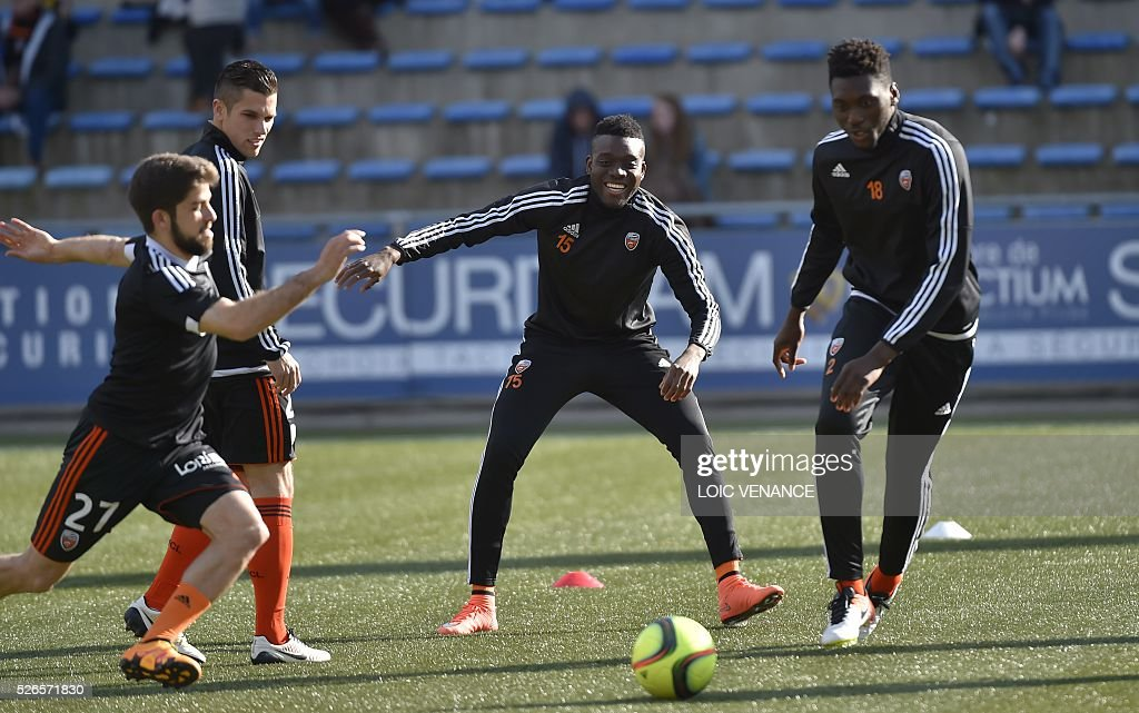 Lorient's players warm up prior to the French L1 football match between Lorient (FCL) and Lyon (OL) at the Moustoir Stadium in Lorient, western France, on April 30, 2016.