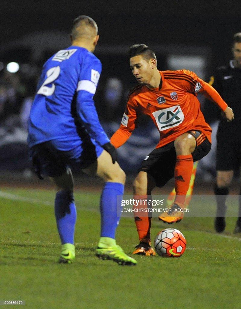 Lorient s Portuguese defender Raphael Guerreiro R vies with