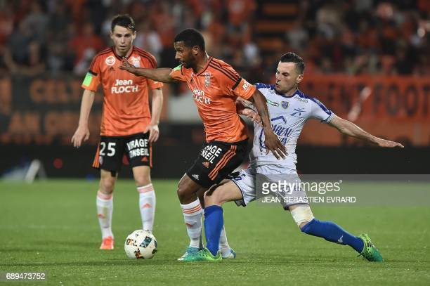 Lorient's Portuguese midfielder Carlos Miguel Cafu vies with Troyes' French midfielder Karim Azamoum during the French L12 playoff football match...