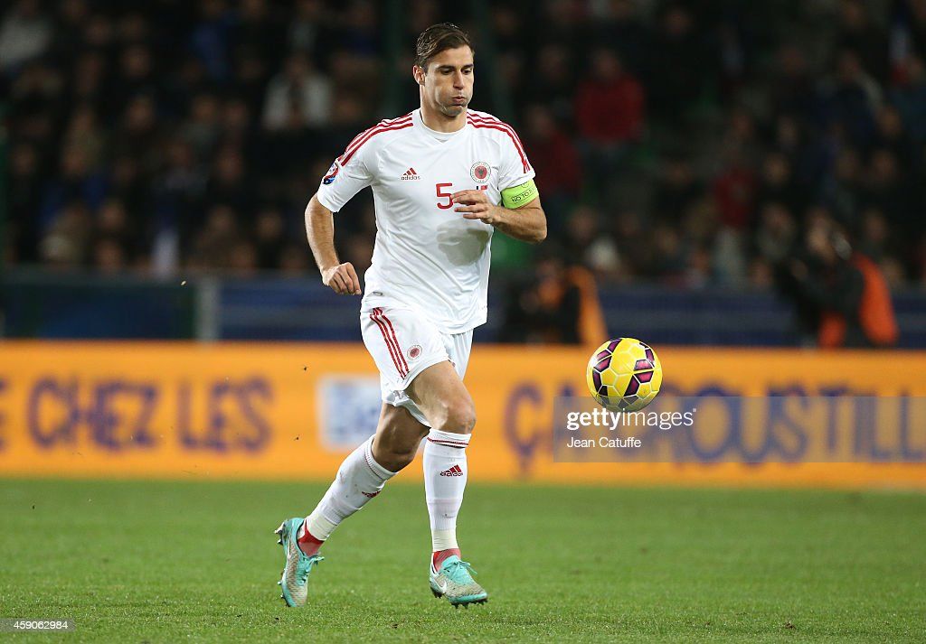 <a gi-track='captionPersonalityLinkClicked' href=/galleries/search?phrase=Lorik+Cana&family=editorial&specificpeople=662499 ng-click='$event.stopPropagation()'>Lorik Cana</a> of Albania in action during the international friendly match between France and Albania at Stade de la Route de Lorient stadium on November 14, 2014 in Rennes, France.