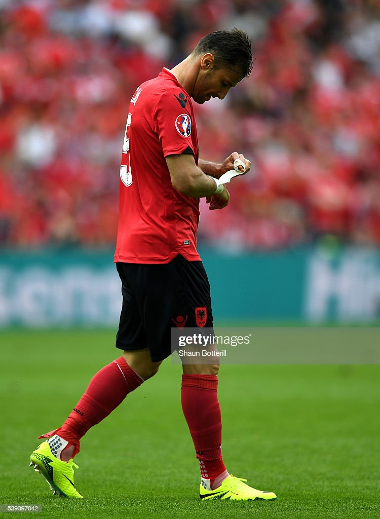 <a gi-track='captionPersonalityLinkClicked' href=/galleries/search?phrase=Lorik+Cana&family=editorial&specificpeople=662499 ng-click='$event.stopPropagation()'>Lorik Cana</a> of Albania walks off the pitch after receiving the second yellow card and sent off during the UEFA EURO 2016 Group A match between Albania and Switzerland at Stade Bollaert-Delelis on June 11, 2016 in Lens, France.