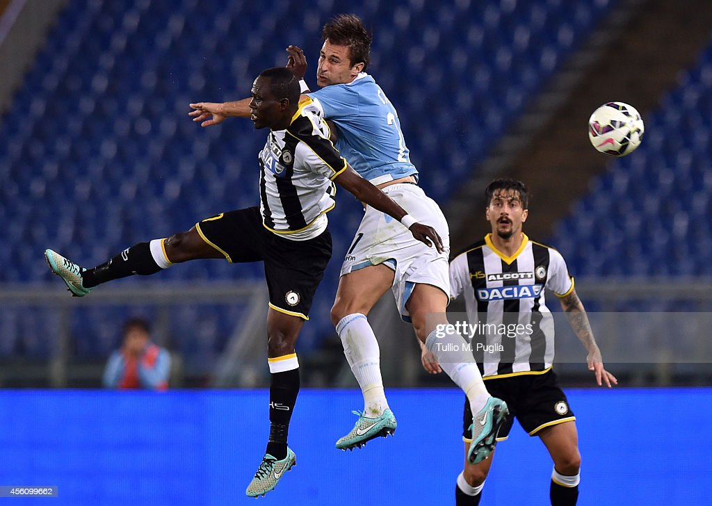 Lorik Cana (R) of Lazio and Emanuel Badu of Udinese jump for the ball during the Serie A match between SS Lazio and Udinese Calcio at Stadio Olimpico on September 25, 2014 in Rome, Italy.