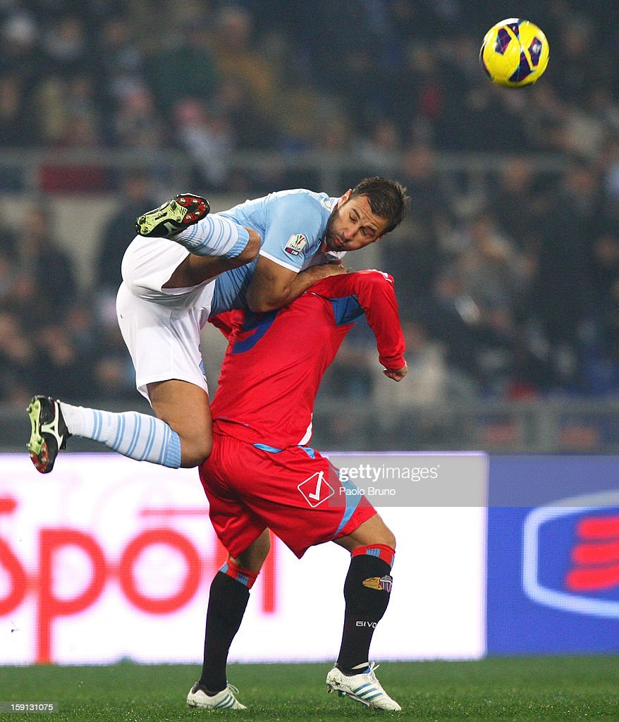 Lorik Cana (L) of S.S. Lazio competes for the ball with Gonzalo Bergessio of Calcio Catania during the TIM Cup match between S.S. Lazio and Calcio Catania at Stadio Olimpico on January 8, 2013 in Rome, Italy.
