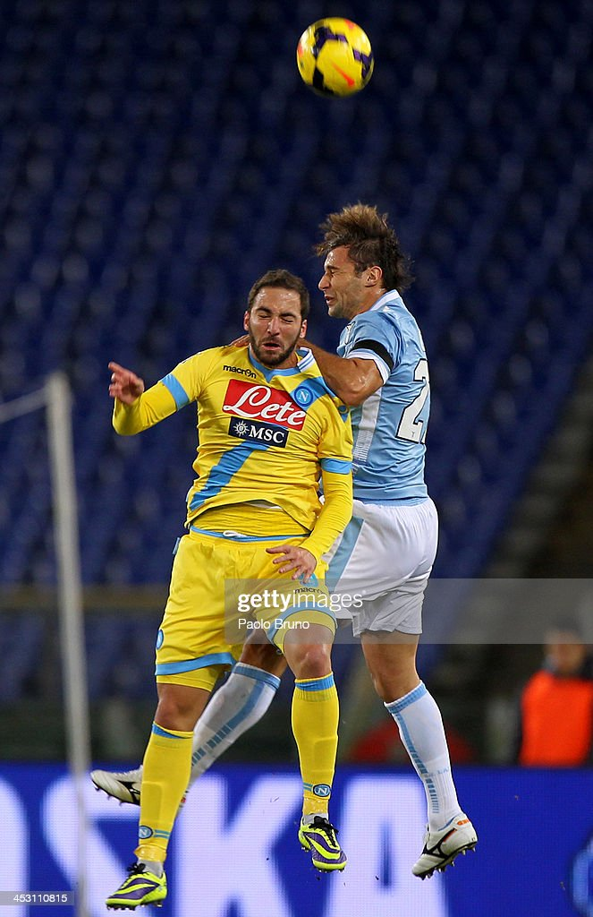<a gi-track='captionPersonalityLinkClicked' href=/galleries/search?phrase=Lorik+Cana&family=editorial&specificpeople=662499 ng-click='$event.stopPropagation()'>Lorik Cana</a> (R) of SS Lazio competes for the ball with <a gi-track='captionPersonalityLinkClicked' href=/galleries/search?phrase=Gonzalo+Higuain&family=editorial&specificpeople=651523 ng-click='$event.stopPropagation()'>Gonzalo Higuain</a> of SSC Napoli during the Serie A match between SS Lazio and SSC Napoli at Stadio Olimpico on December 2, 2013 in Rome, Italy.