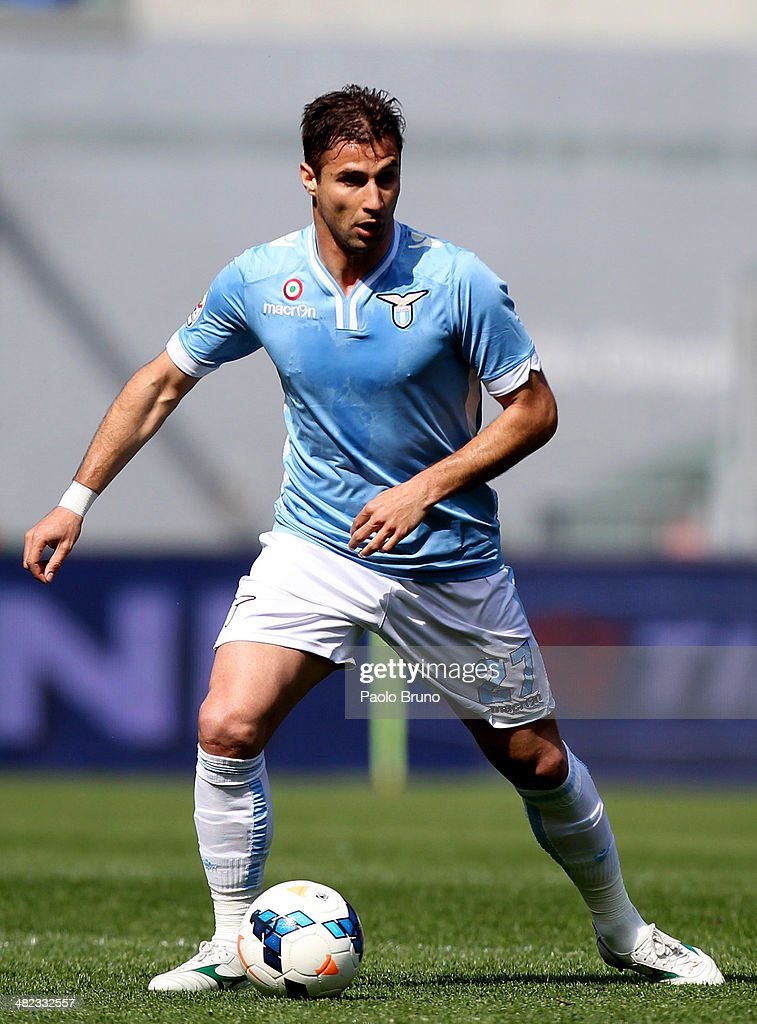 <a gi-track='captionPersonalityLinkClicked' href=/galleries/search?phrase=Lorik+Cana&family=editorial&specificpeople=662499 ng-click='$event.stopPropagation()'>Lorik Cana</a> of SS Lazio in action during the Serie A match between SS Lazio and Parma FC at Stadio Olimpico on March 30, 2014 in Rome, Italy.