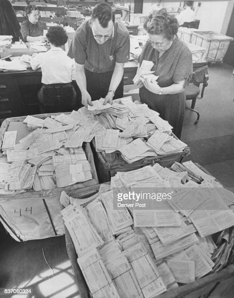 Lorin L Chase IRS mail unit supervisor and his assistant Mrs Regina Winters check the flood of paper Tide of Tax Returns Flows to IRS Office Credit...