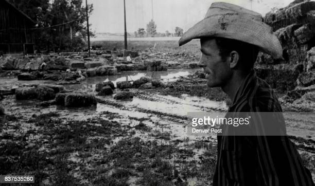 Loring Goodan A lease Farmer Looks over Remains of Floodwater From Deer Creek The water smashed at his barn and five tons of stacked hay and also...