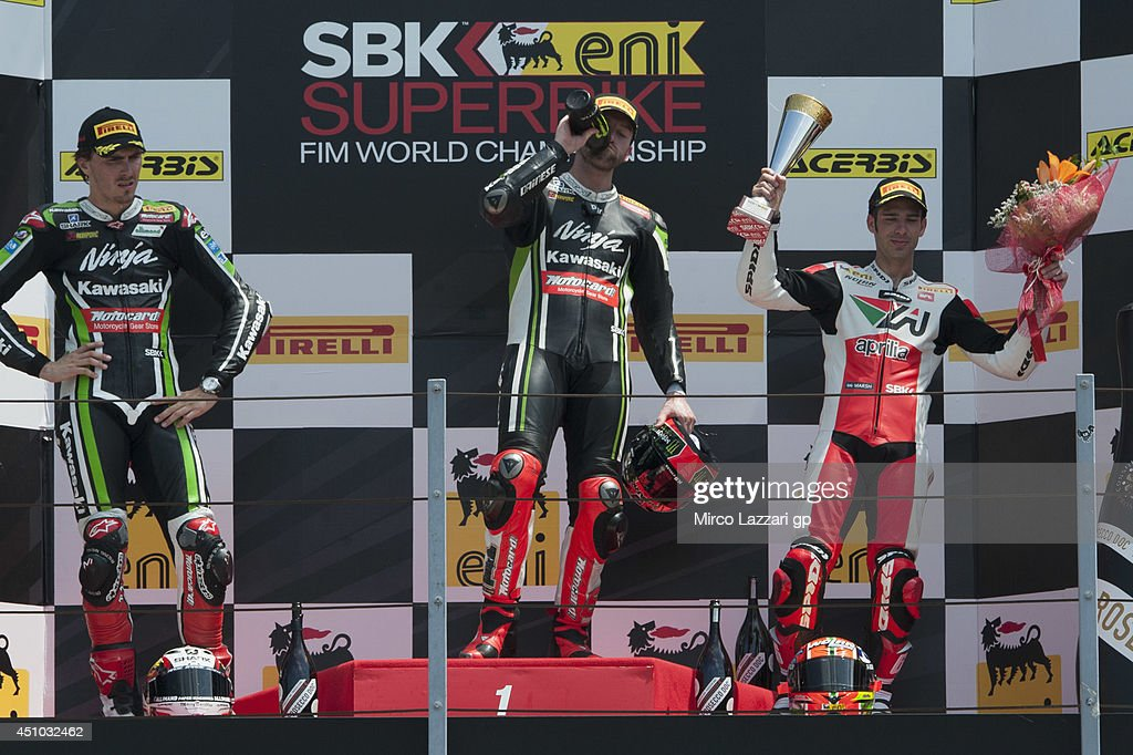 <a gi-track='captionPersonalityLinkClicked' href=/galleries/search?phrase=Loris+Baz&family=editorial&specificpeople=5600630 ng-click='$event.stopPropagation()'>Loris Baz</a> of France and Kawasaki Racing Team, <a gi-track='captionPersonalityLinkClicked' href=/galleries/search?phrase=Tom+Sykes&family=editorial&specificpeople=3070262 ng-click='$event.stopPropagation()'>Tom Sykes</a> of Great Britain and Kawasaki Racing Team and <a gi-track='captionPersonalityLinkClicked' href=/galleries/search?phrase=Marco+Melandri&family=editorial&specificpeople=204382 ng-click='$event.stopPropagation()'>Marco Melandri</a> of Italy and Aprilia Racing Team celebrate on the podium at the end of the Superbike race 2 during the FIM Superbike World Championship - Race at Misano World Circuit on June 22, 2014 in Misano Adriatico, Italy.