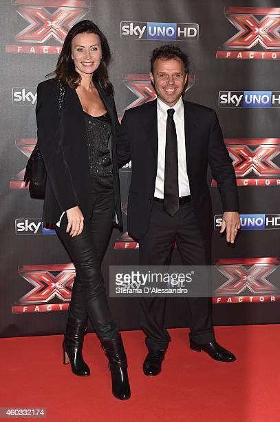 Loris Capirossi and guest attend the X Factor TV Show Final on December 11 2014 in Milan Italy