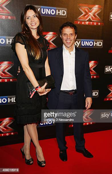 Loris Capirossi and guest attend 'X Factor 2013 The Final' Red Carpet on December 12 2013 in Milan Italy