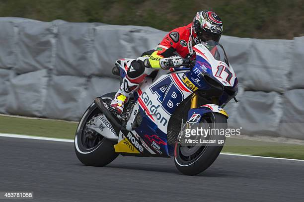 Loris Capirossi of Italy and Dorna FIM Security Commission heads down a straight with the bike of Karel Abraham of Czech and Cardion AB Motoracing...