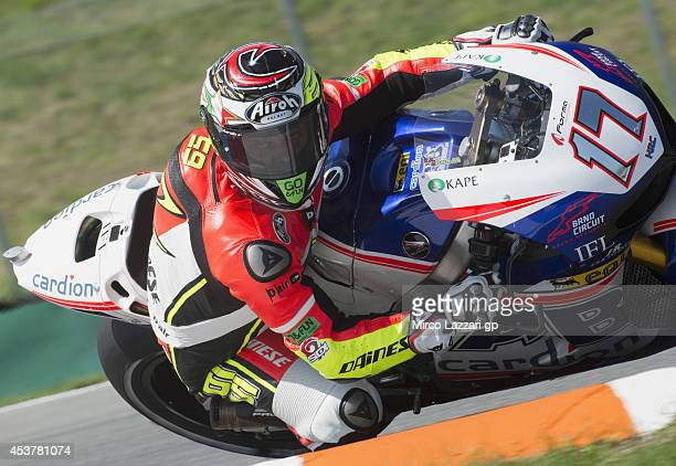 Loris Capirossi of Italy and Dorna FIM Security Commission rounds the bend with the bike of Karel Abraham of Czech and Cardion AB Motoracing during...