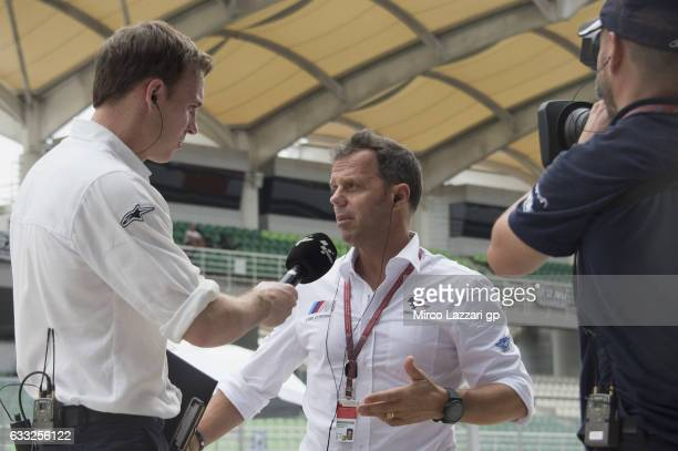 Loris Capirossi of Italy and Dorna FIM Security Commission speaks with journalists in pit during the MotoGP Tests In Sepang at Sepang Circuit on...