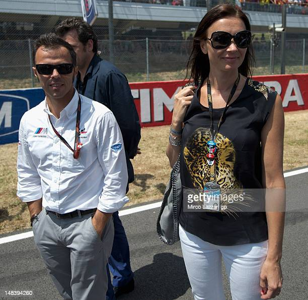 Loris Capirossi of Italy and his wife Ingrid Capirossi walk on the grid during the MotoGP race of the MotoGP of Italy at Mugello Circuit on July 15...