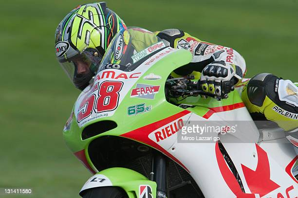 Loris Capirossi of Italy and Pramac Racing Team displays the number 58 as his race number on his bike in tribute to Italian rider Marco Simoncelli as...