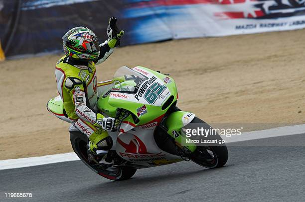 Loris Capirossi of Italy and Pramac Racing Team greets the fans at the end of the free practice of Red Bull US Grand Prix at Mazda Raceway Laguna...