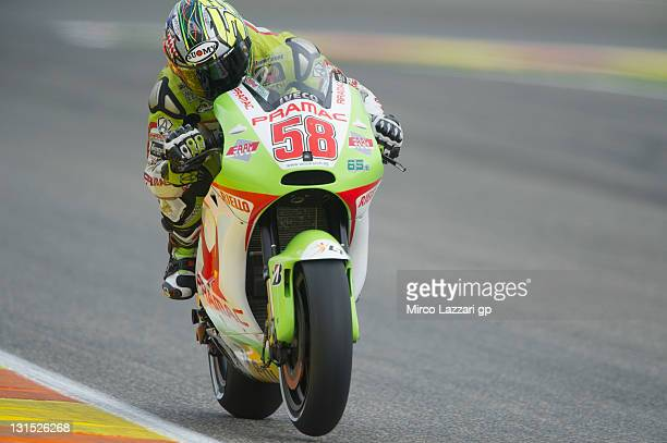 Loris Capirossi of Italy and Pramac Racing Team heads down a straight during the qualifying practice of the MotoGP of Valencia at Ricardo Tormo...