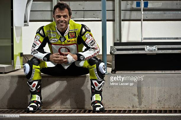 Loris Capirossi of Italy and Pramac Racing Team looks on in pit during the first day of MotoGP Tests at Losail Circuit on March 13 2011 in Doha Qatar