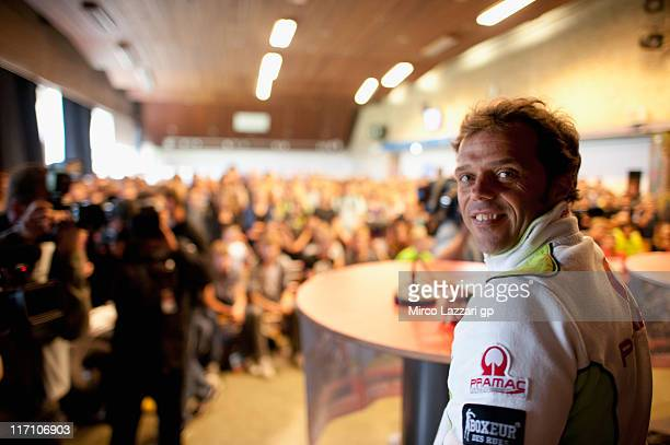 Loris Capirossi of Italy and Pramac Racing Team smiles during the preevent 'Riders visit the Dr Nassau College a Technical School in Assen' during...