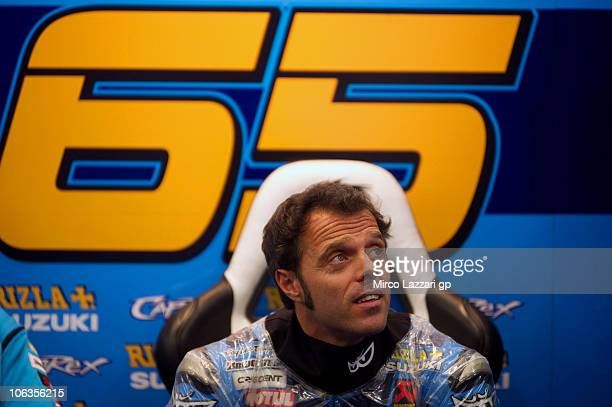 Loris Capirossi of Italy and Rizla Suzuki MotoGP looks on in the team garage during the first free practice of the MotoGP of Portugal on October 29...