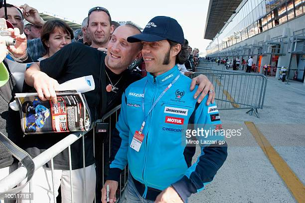 Loris Capirossi of Italy and Rizla Suzuki MotoGP poses for fans during the 'Pit Lane Walk' of the MotoGP French Grand Prix in Le Mans Circuit on May...