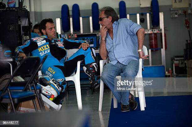 Loris Capirossi of Italy and Rizla Suzuki Team speaks with Carlo Pernat of Italy in box during the final day of the MotoGP test at Sepang...