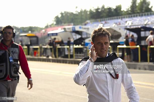 Loris Capirossi of Italy walks in pit during the MotoGp of Czech Republic Free Practice at Brno Circuit on August 23 2013 in Brno Czech Republic