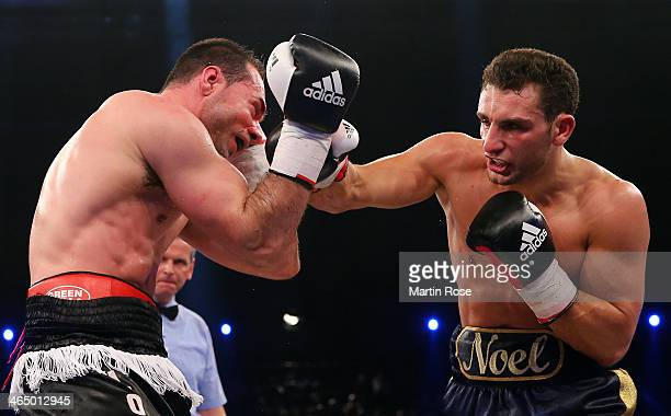 Loris Emiliani of Switzerland exchanges punches with Noel Gevor of Germany during their cruiser weight fight at HansMartinSchleier on January 25 2014...