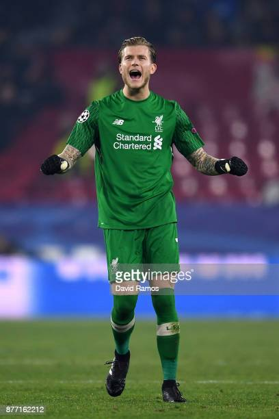 Loris Karius of Liverpool celebrates after Roberto Firmino of Liverpool scored their sides third goal during the UEFA Champions League group E match...