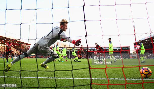 Loris Karius of Liverpool dives in vaine as as Steve Cook of AFC Bournemouth scores their third goal during the Premier League match between AFC...