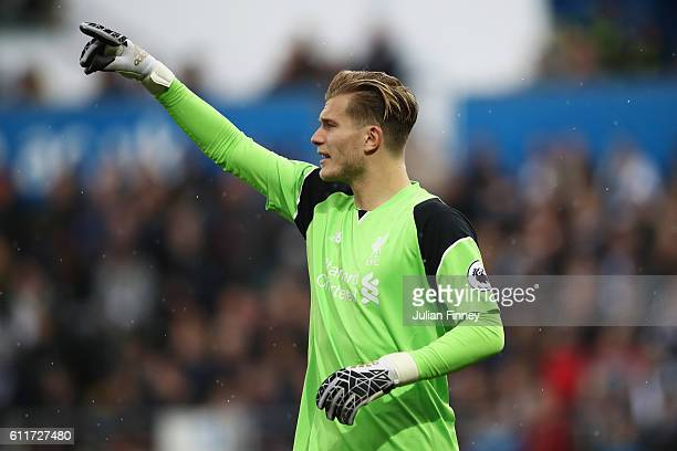 Loris Karius of Liverpool gives his defenders instructions during the Premier League match between Swansea City and Liverpool at Liberty Stadium on...
