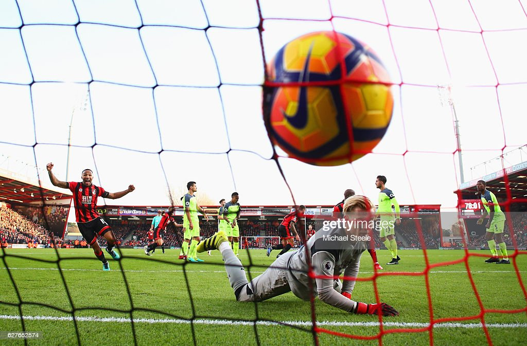 Loris Karius of Liverpool looks dejected as Callum Wilson of AFC Bournemouth celebrates as Steve Cook of AFC Bournemouthscores their third goal during the Premier League match between AFC Bournemouth and Liverpool at Vitality Stadium on December 4, 2016 in Bournemouth, England.