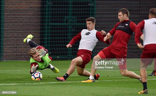 Loris Karius of Liverpool makes a ave from Cameron Brannagan during a training session at Melwood Training Ground on October 9 2017 in Liverpool...