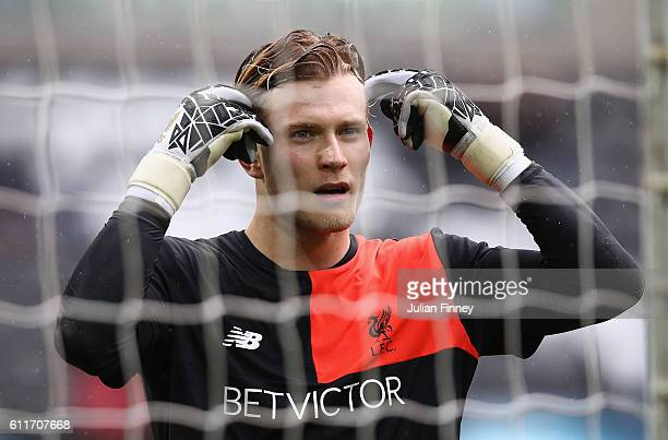 Loris Karius of Liverpool warms up piror to kick off during the Premier League match between Swansea City and Liverpool at Liberty Stadium on October...