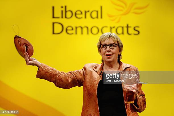 Lorley Burt MP for Solihull walks on stage wearing a Nigel Farage mask prior to Nick Clegg deputy prime minister and leader of the Liberal Democrats...