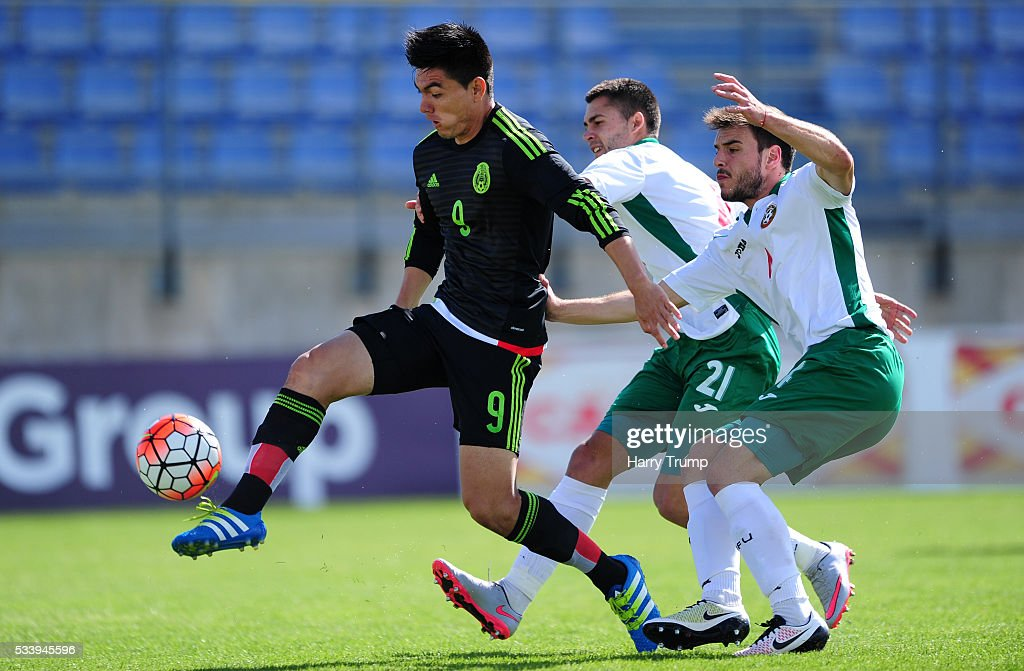 Lorona Aguilar of Mexico is tackled by Lazer Martin of Bulgaria during the Toulon Tournament match between Bulgaria and Mexico at Stade Perruc on May 24, 2016 in Hyeres, France.